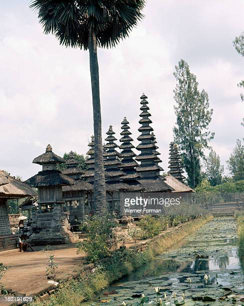 The water around the pagoda roofed shrines at the Pura Taman Ayun recalls the primeval ocean from which the cosmic mountain Mount Meru symbolized by...