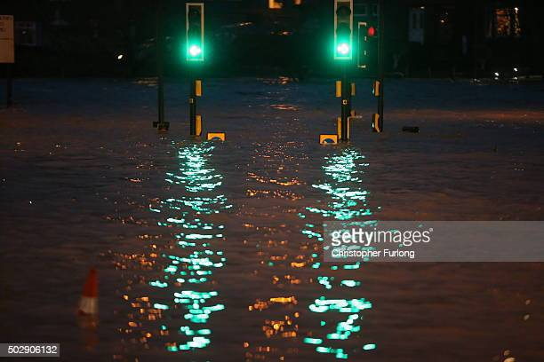 The water continues to rise as the River Nith bursts its banks on December 30, 2015 in Dumfries, Scotland. Severe flooding has affected large parts...