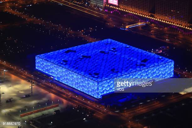 The Water Cube displays blue lighting to welcome Lunar New Year on February 15 2018 in Beijing China The year of the dog is celebrated from the first...