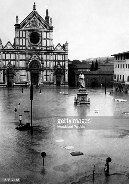 The water floods the square in front of the basilica of Santa Croce dominated by the statue of Dante made by Enrico Pazzi Florence 1966