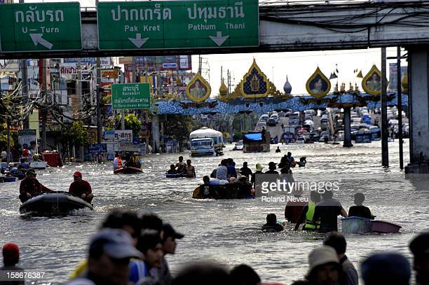 The water have just risen in this area of Pathum Thani and people are trying to adapt to a new daytoday routine without basic facilities