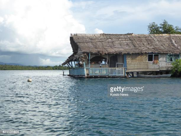 The water level of Langa Langa Lagoon in the Solomon Islands' Malaita Province almost reaches the verandah of a Busu village house on Nov 4 2017 The...