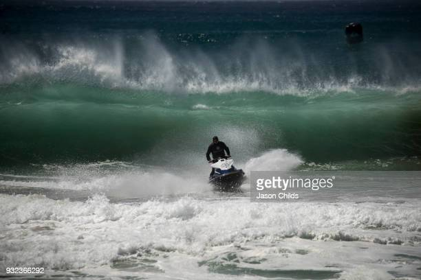 The water patrol for the World Surf League Championship Tour out run big surf today on the Gold Coast of Australia in the Quiksilver Pro Gold Coast...