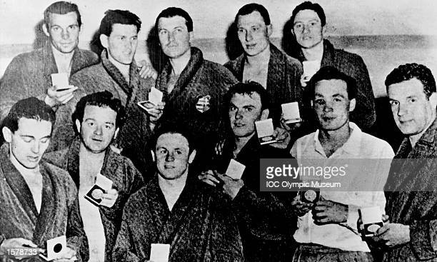 The water polo team of Hungary pose with their gold medals after winning their event at the 1956 Olympic Games in Melbourne Altogether they have won...