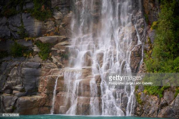 the waterfall of the lake todos los santos close view during the andean lake crossing - azul turquesa stockfoto's en -beelden