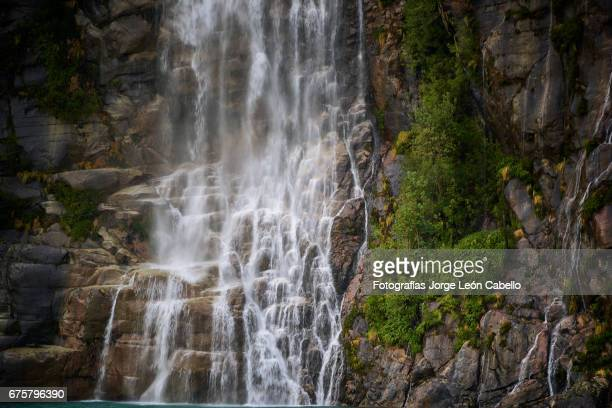 the waterfall of the lake todos los santos close view during the andean lake crossing - azul turquesa stock pictures, royalty-free photos & images