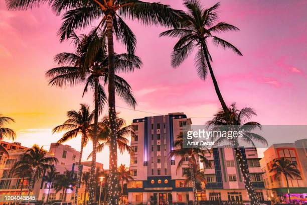 the waterfront of the famous ocean driver art deco district of miami beach with stunning sunset. - miami foto e immagini stock