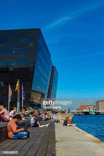 the waterfront on the main canal in copenhagen - quayside stock pictures, royalty-free photos & images
