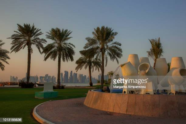 The waterfront promenade of Doha Corniche during sunset