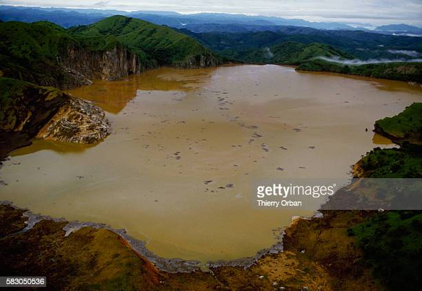 The waters Lake Nyos near Wum Cameroon have turned a murky brown following a deadly release of toxic gas In August of 1986 the lake which is located...