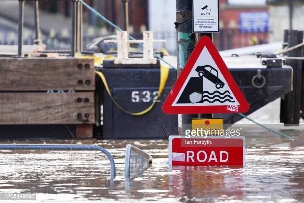 The waters of the River Ouse passing through York breach the river banks causing flooding as water levels rise on February 11, 2020 in York, England....