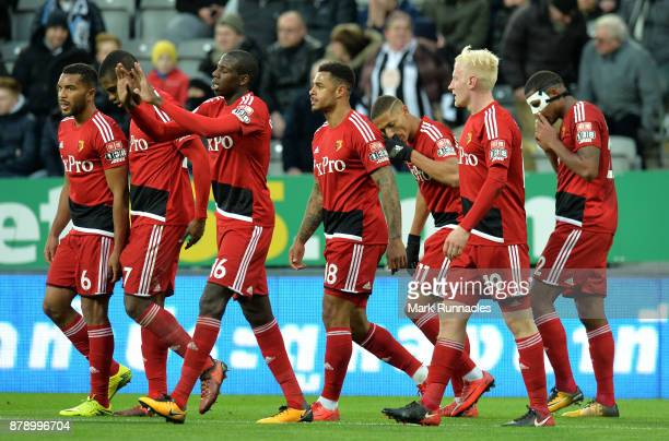 The Watford team celebrate there sides second goal as Deandre Yedlin of Newcastle United scored a own goal during the Premier League match between...