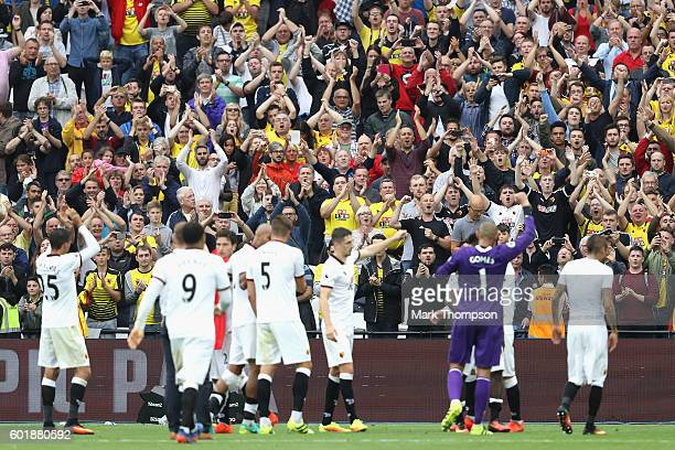 The Watford team show their appreaction to the Watford fans during the Premier League match between West Ham United and Watford at Olympic Stadium on...
