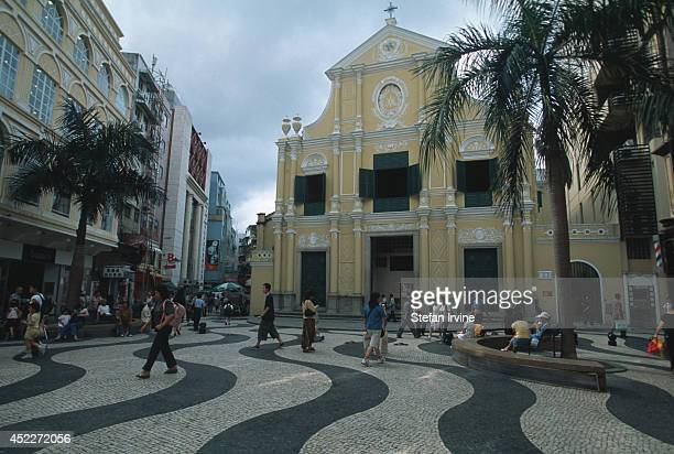 The wavepatterned pavement of the Largo do Senado and the beautifullyrestored church of Sao Dominos
