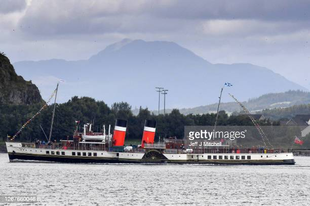 The Waverley paddle steamer passes Ben Lomond mountain as it returns to sailing on the Clyde following a successful campaign to raise £23 million for...