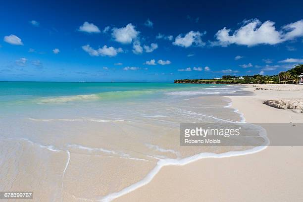 The waves of the Caribbean Sea crashing on the white sandy beach of Runaway Bay, north of the capital St. Johns, Antigua, Leeward Islands, West Indies, Caribbean, Central America