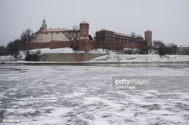 The Wawel Castle seen as the Vistula river is partially frozen in Krakow