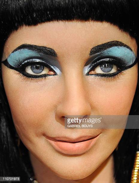 "The wax figure of Elizabeth Taylor in one of her most famous roles ""Cleopatra"" is pictured at Madame Tussauds in Hollywood California on March 23..."