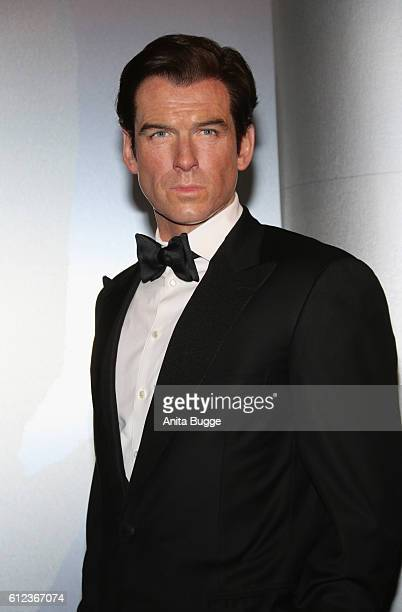 The wax figure of Pierce Brosnan as James Bond is unveiled at Madame Tussauds on October 4, 2016 in Berlin, Germany. Madame Tussauds in Berlin is...
