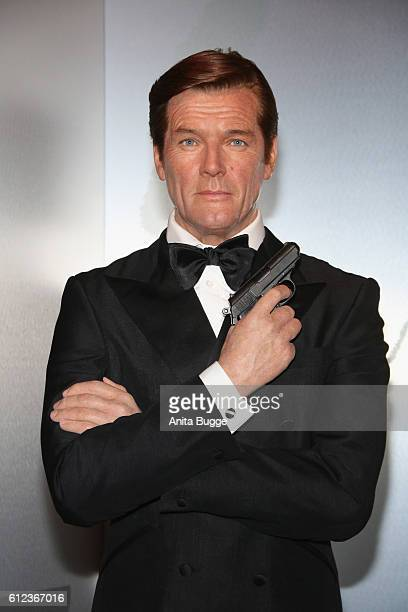 The wax figure of Roger Moore as James Bond is unveiled at Madame Tussauds on October 4 2016 in Berlin Germany Madame Tussauds in Berlin is unveiling...