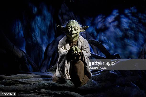 The wax figure of Star Wars character Yoda is pictured at the Star Wars At Madame Tussauds attraction in London on May 12 2015 AFP PHOTO/JUSTIN TALLIS