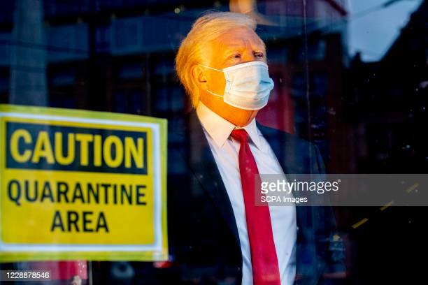 The wax figure of US President Donald Trump has also been 'quarantined' at Madame Tussauds, in Amsterdam. The statue has a face mask in front of the...