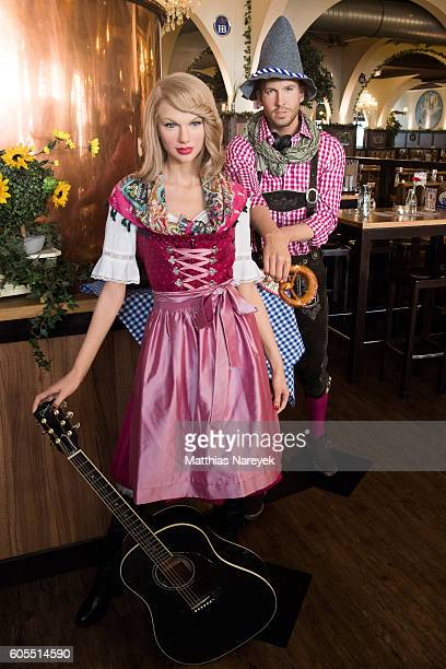 The wax figures of Calvin Harris and Taylor Swift dressed in traditional Bavarian clothing are displayed at Hofbraeuhaus Berlin on September 14 2016...