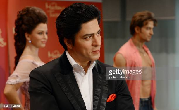The wax figures of Indian Bollywood stars Aishwarya Rai Shah Rukh Khan and Hrithik Roshan are pictured at the Indian embassy in Berlin Germany 18...