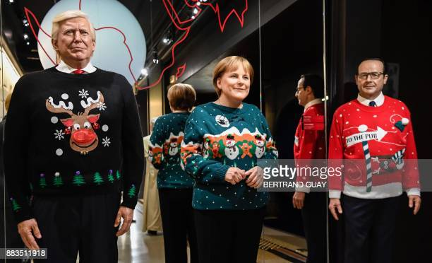 The wax figures of US President Donald Trump German Chancellor Angela Merkel and former French President Francois Hollande are pictured in...