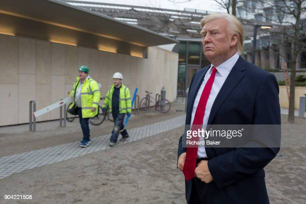 The waxwork of Donald Trump stands outside the US Embassy at Nine Elms in south London on the day when the President announced on Twitter his refusal...