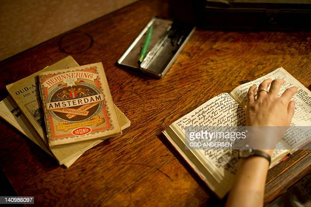 The waxwork representing Anne Frank writing in her diary is seen at Madame Tussaud's wax museum in Berlin on March 9 2012 In 1942 Anne Frank and her...