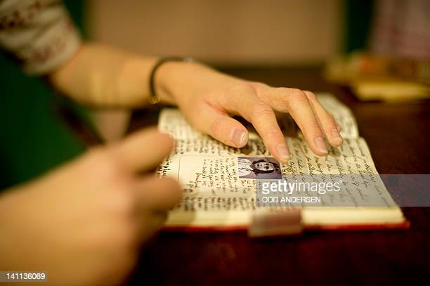 The waxworks representing Anne Frank writing in her diary is seen at Madame Tussaud's wax museum in Berlin on March 9 2012 In 1942 Anne Frank and her...