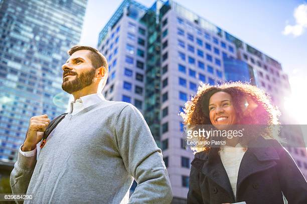 The way for success, business couple standing outside office buildings