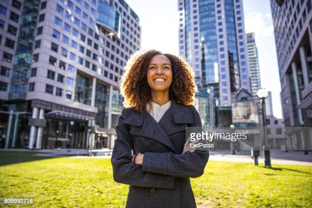 The way for success, woman standing outside office buildings