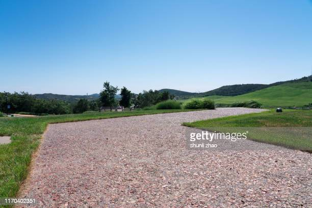 the way on the grassland - paved driveway stock pictures, royalty-free photos & images