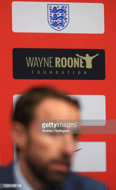 The Wayne Rooney Foundation logo is seen as Gareth Southgate manager of England attends an England press conference to announce the squad for the...