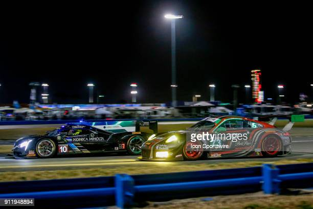 The Wayne Taylor Racing Cadillac DPiVR of Ryan HunterReay Jordan Taylor and Renger van der Zande and the Park Place Motorsports Porsche 911 GT3 R of...