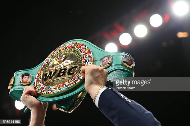 The WBC super middleweight championship belt is held in the air at the DC Armory on April 30 2016 in Washington DC