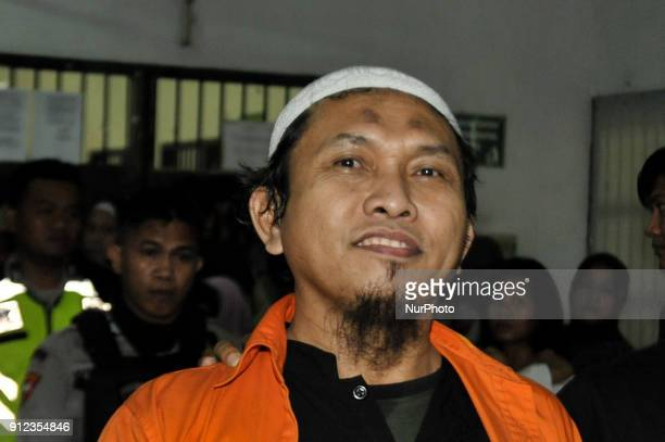 The weapons smuggler for Indonesia terrorist network from Southern Philippines Suryadi Mas'ud arrives at West Jakarta District Court in Jakarta...