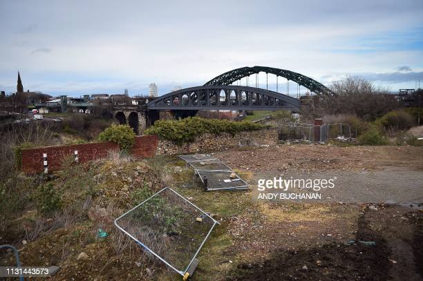 The Wearmouth road and rail bridges are seen across waste ground in Sunderland in north east England on March 16 2019 The former shipbuilding city in...