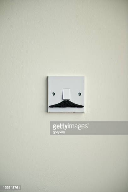 The Weasel Mustache Light Switch