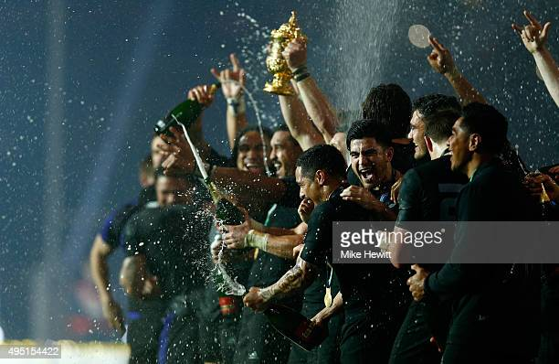 The Webb Ellis Cup is lifted by Richie McCaw of New Zealand as New Zealand celebrate victory in the 2015 Rugby World Cup Final match between New...