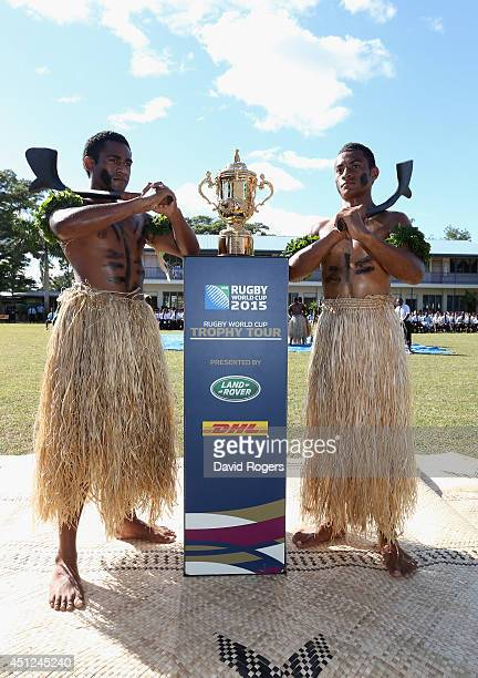 The Webb Ellis Cup is welcomed by members of Ratu Navula Secondary School rugby team in Nadi kicking off the Rugby World Cup Trophy Tour in Fiji in...