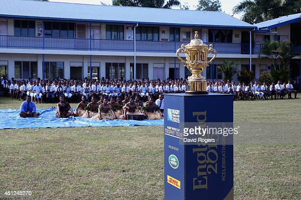 The Webb Ellis Cup is welcomed by pupils from Ratu Navula Secondary School in Nadi kicking off the Rugby World Cup Trophy Tour in Fiji in partnership...