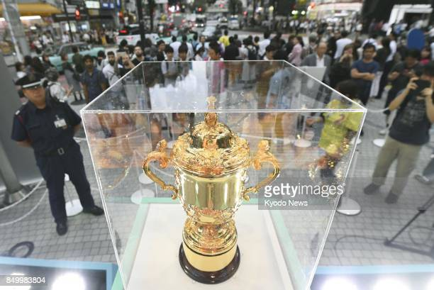 The Webb Ellis Cup the trophy awarded to the winner of the Rugby World Cup is on display in Tokyo's Shibuya district on Sept 20 exactly two years...