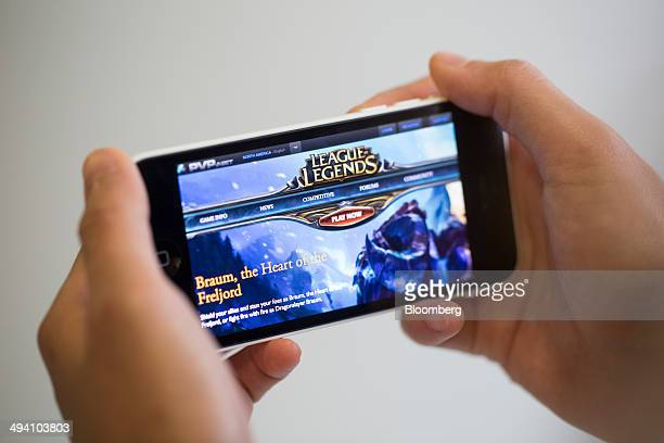The website for League of Legends a game developed by Riot Games Inc a subsidiary of Tencent Holdings Ltd is displayed on an Apple Inc iPhone 5c in...