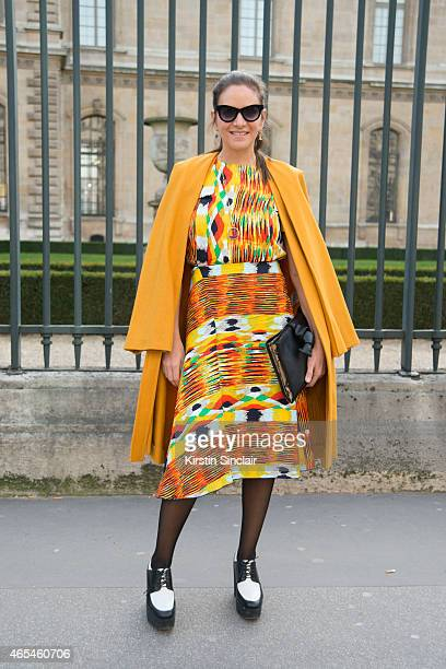 The Webster owner Laure Heriard Dubreuil wears a vintage Balenciaga coat Celine dress and shoes and Italian Independent sunglasses on day 4 of Paris...