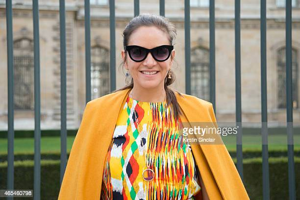 The Webster owner Laure Heriard Dubreuil wears a vintage Balenciaga coat Celine dress and Italian Independent sunglasses on day 4 of Paris...