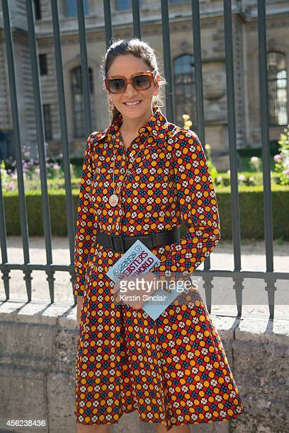 The Webster Store Owner Laure Heriard Dubreuil is wearing a vintage Yves Saint Laurent dress and Charlotte Olympia bag on day 4 of Paris Collections...