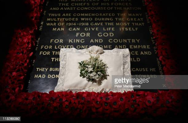 The wedding bouquet of Catherine Duchess of Cambridge lies on the grave of the unknown warrior in Westminster Abbey on April 30 2011 in London...